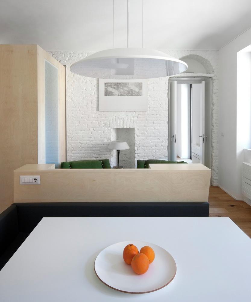 Turin apartment renovation solid brick wall