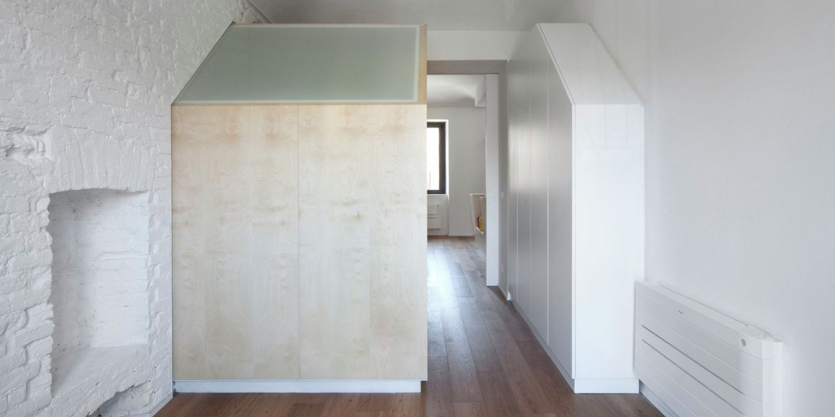 Turin apartment renovation wood volumes on hallway