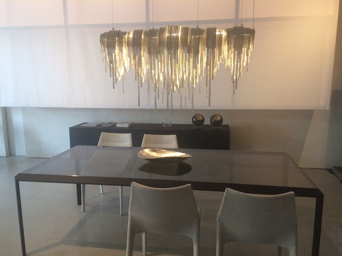 This Volver chandelier is manufactured in Italy.