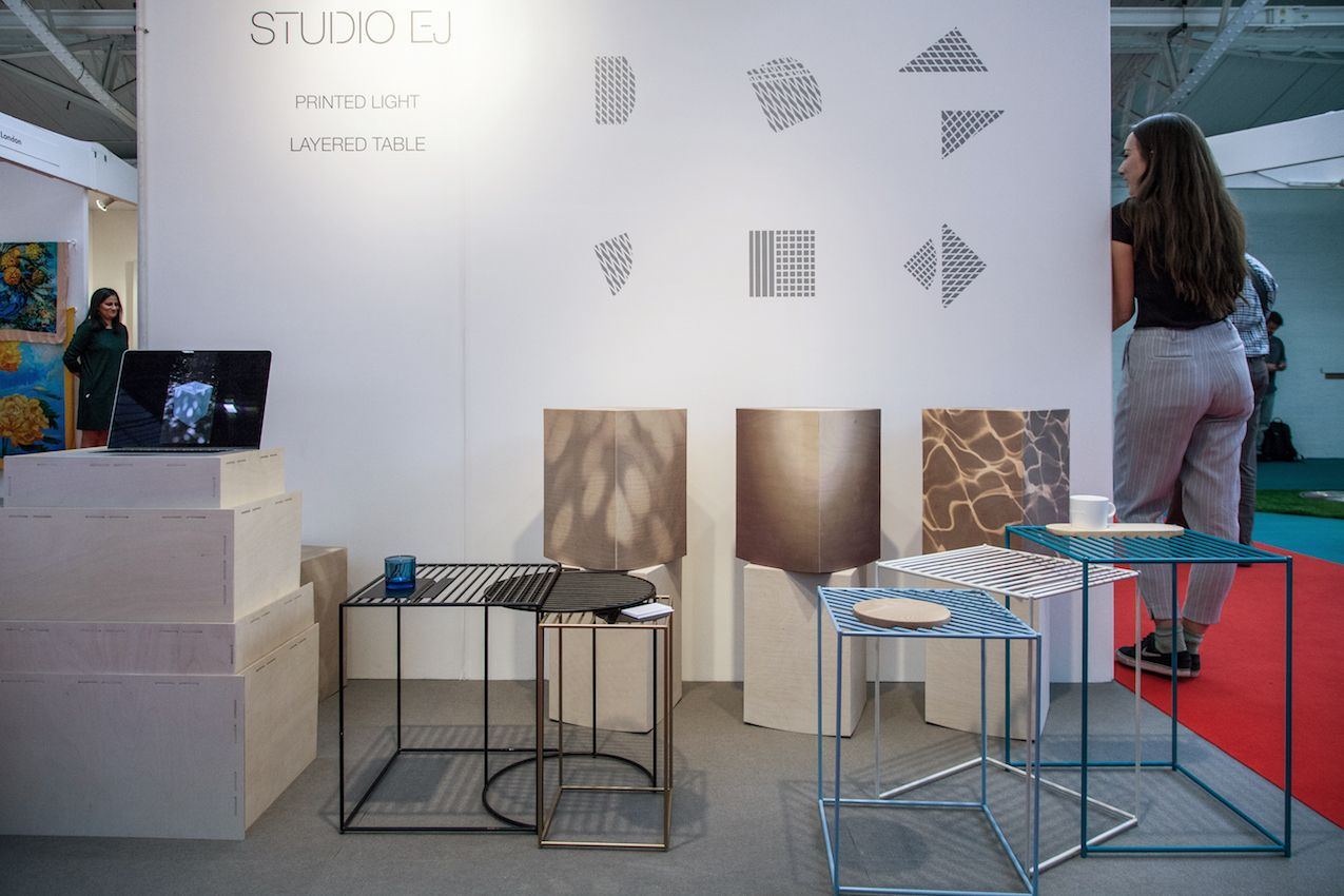 Studio EJ's Layered Tables are avail;able in aluminum and wood.