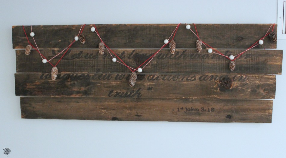 Wood plank decorated with gerlands for Christmas