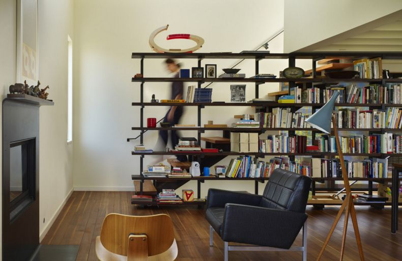 large bookcase that doubles as a partitio