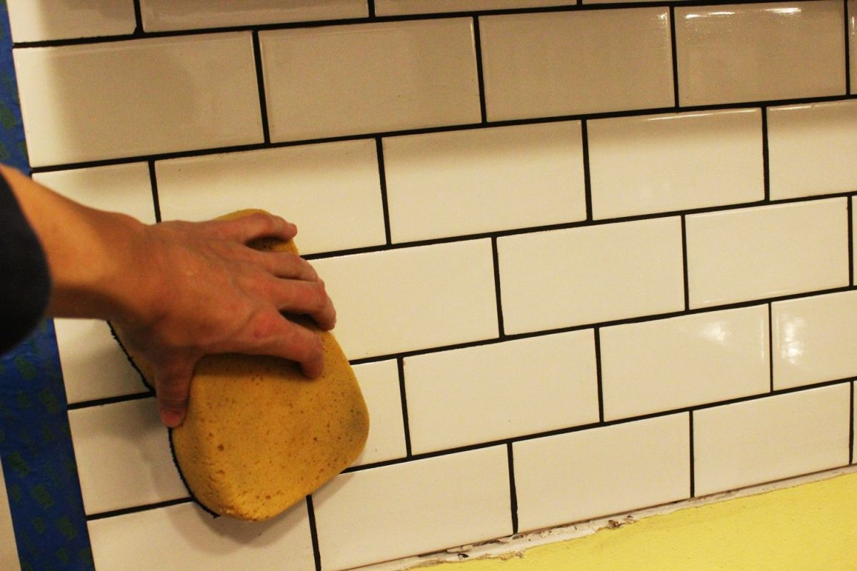 leaving most of the grout in the spaces
