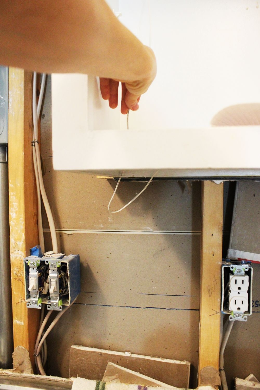 pull the excess wire up through the cabinet bottom