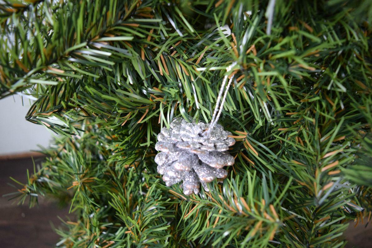 Adding pinecones to tree