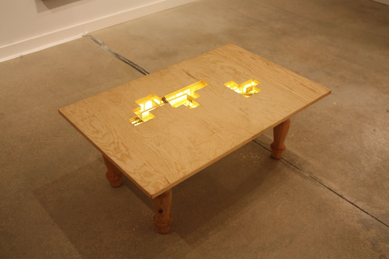 From a distance, this looks like a plain plywood table, but as you approach, it reveals a wonderful surprise.