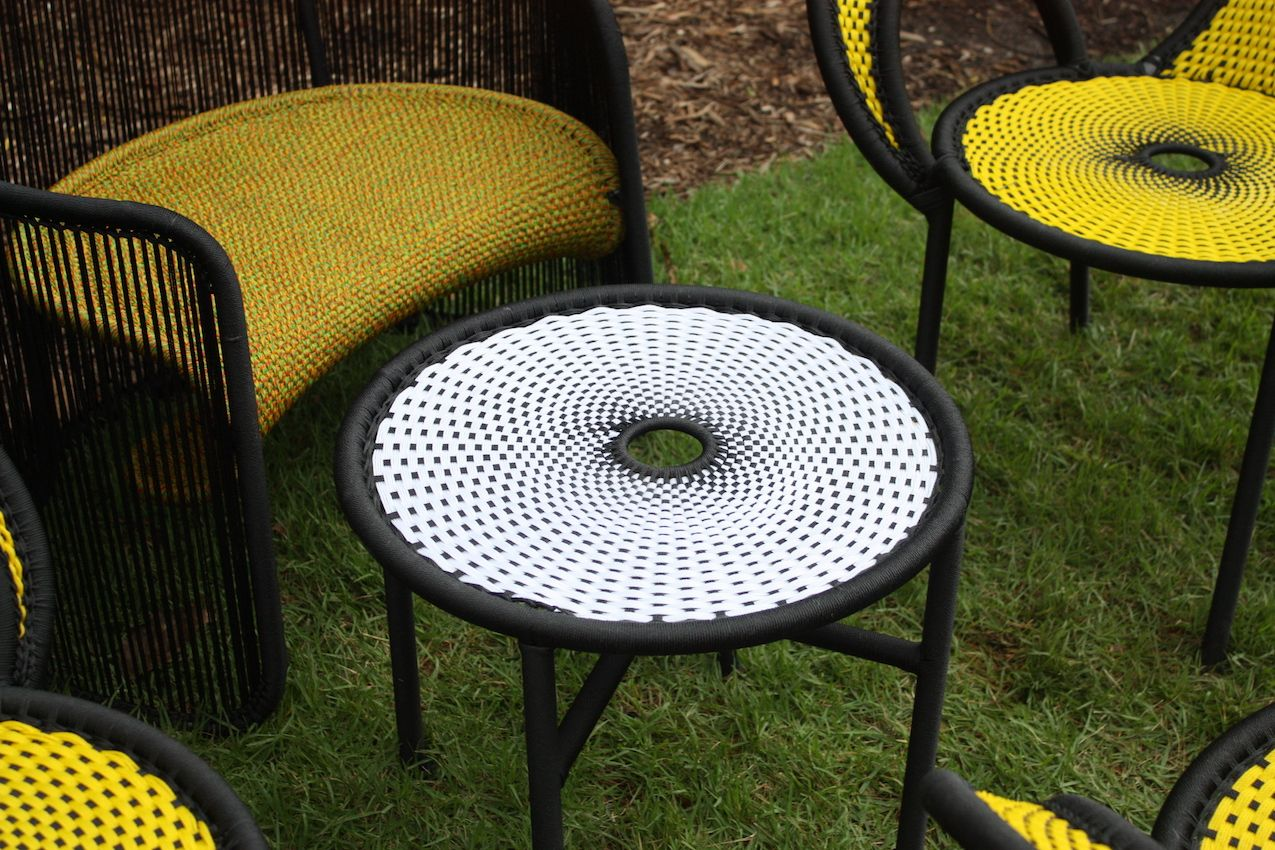 Artful weaving give the seats and table an optic geometric design.