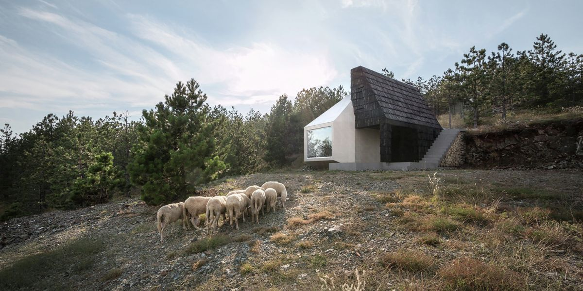 Black and white house in Serbia built into the site