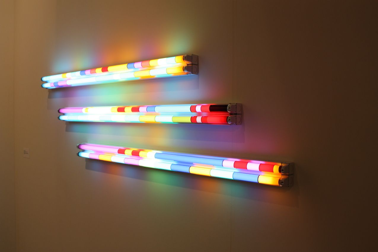 Colored bar of lights are both art installation and mood lighting.