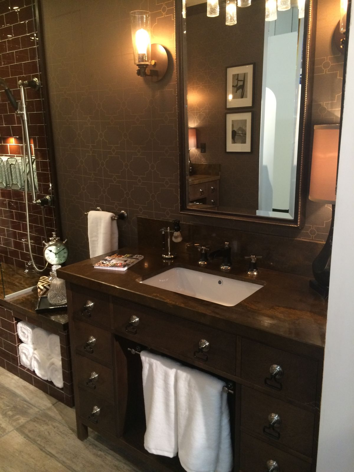This dresser-style vanity offers plenty of storage space as well as room for hanging hand towels without taking up wall space.