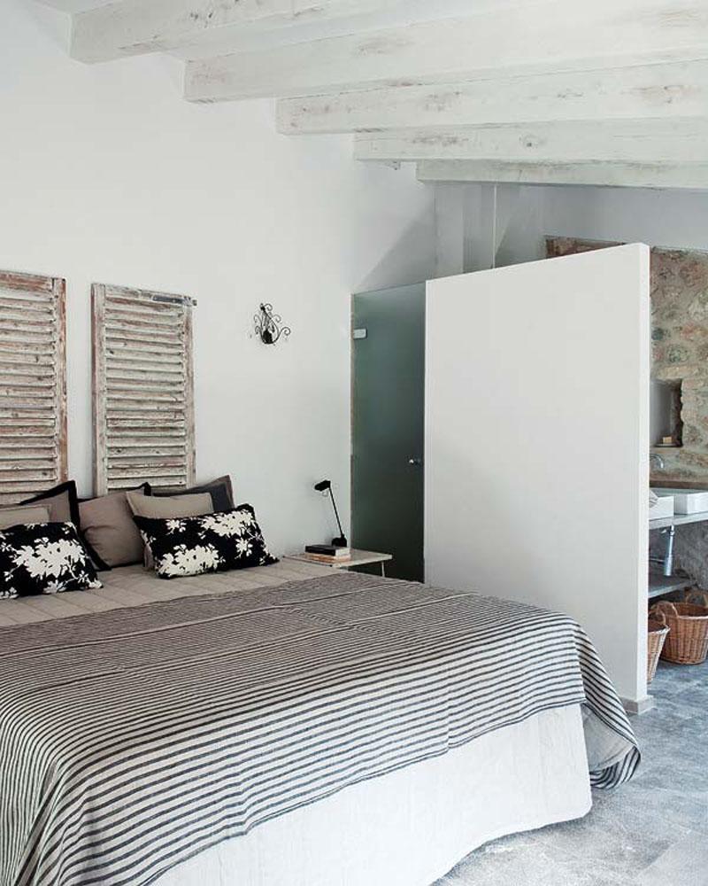 Feminine Bedroom Featuring Window Wood shutters used like headboard