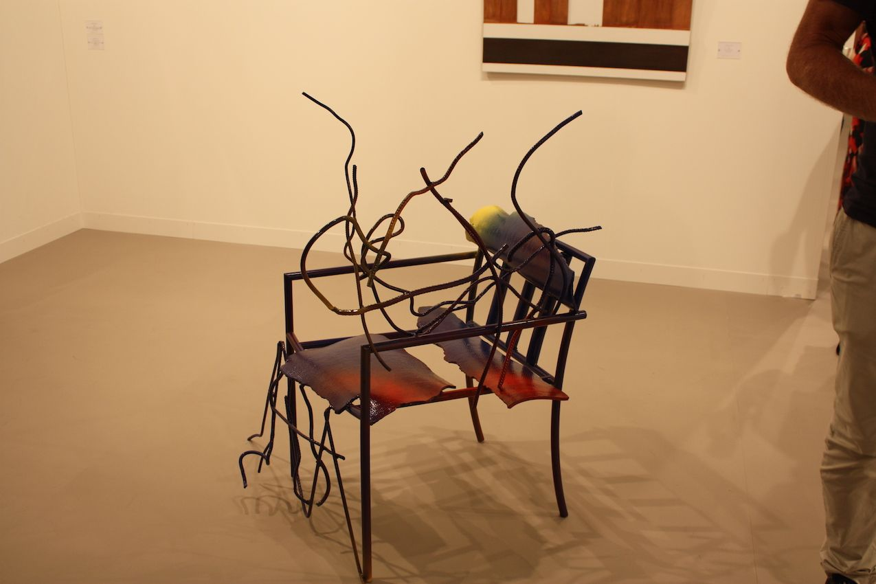 While this piece is art where form and expression take precedence, from this angle one can imagine sitting down and having the metal snake around you like growing vines.