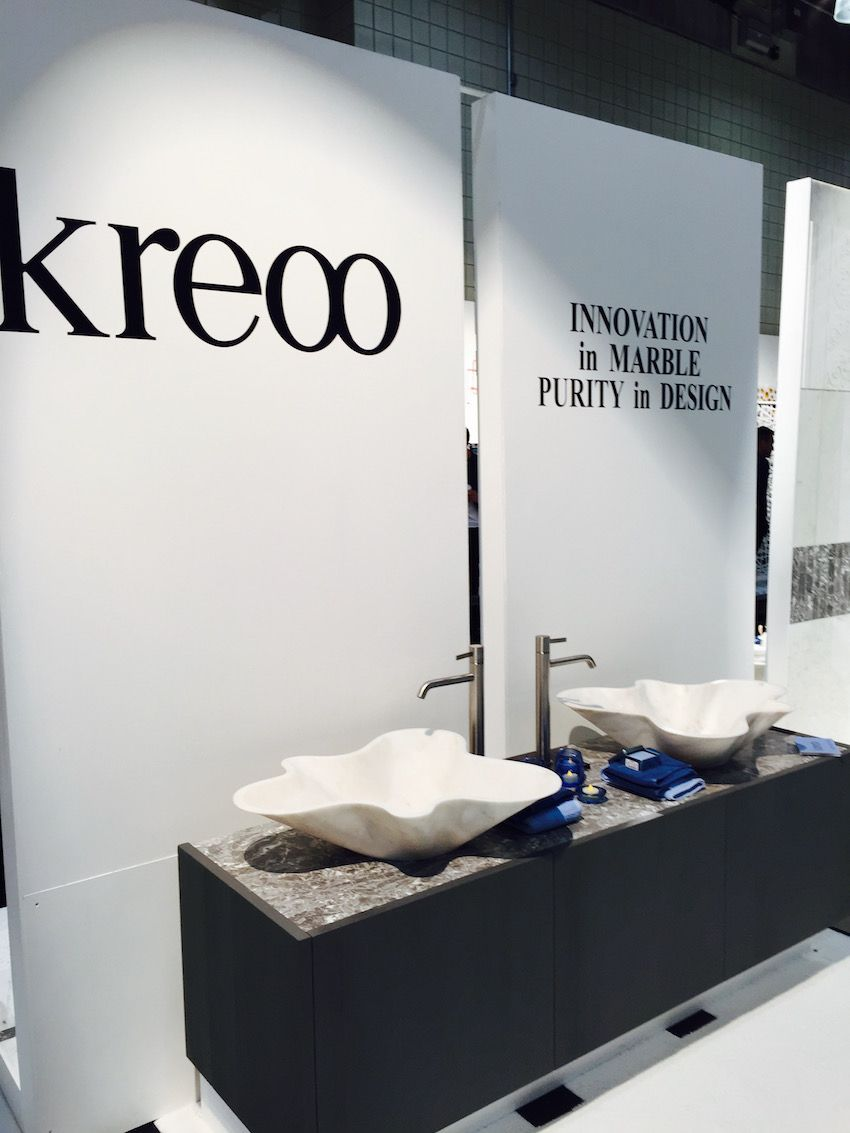 "Kreoo describes these hand-carved marble basins as having ""light curves that burst like a flower."""