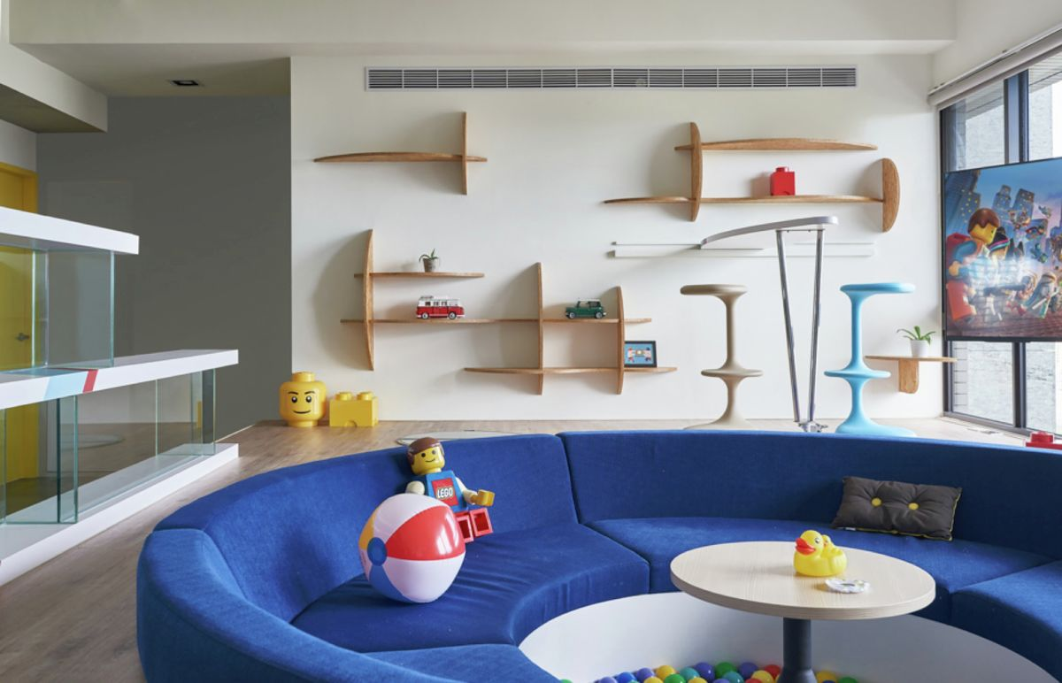 LEGO-inpired apartment in Taiwan curvaceous wall shelves