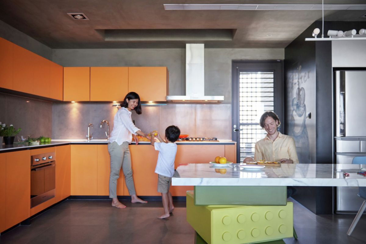 LEGO-inpired apartment in Taiwan kitchen orange and gray combo