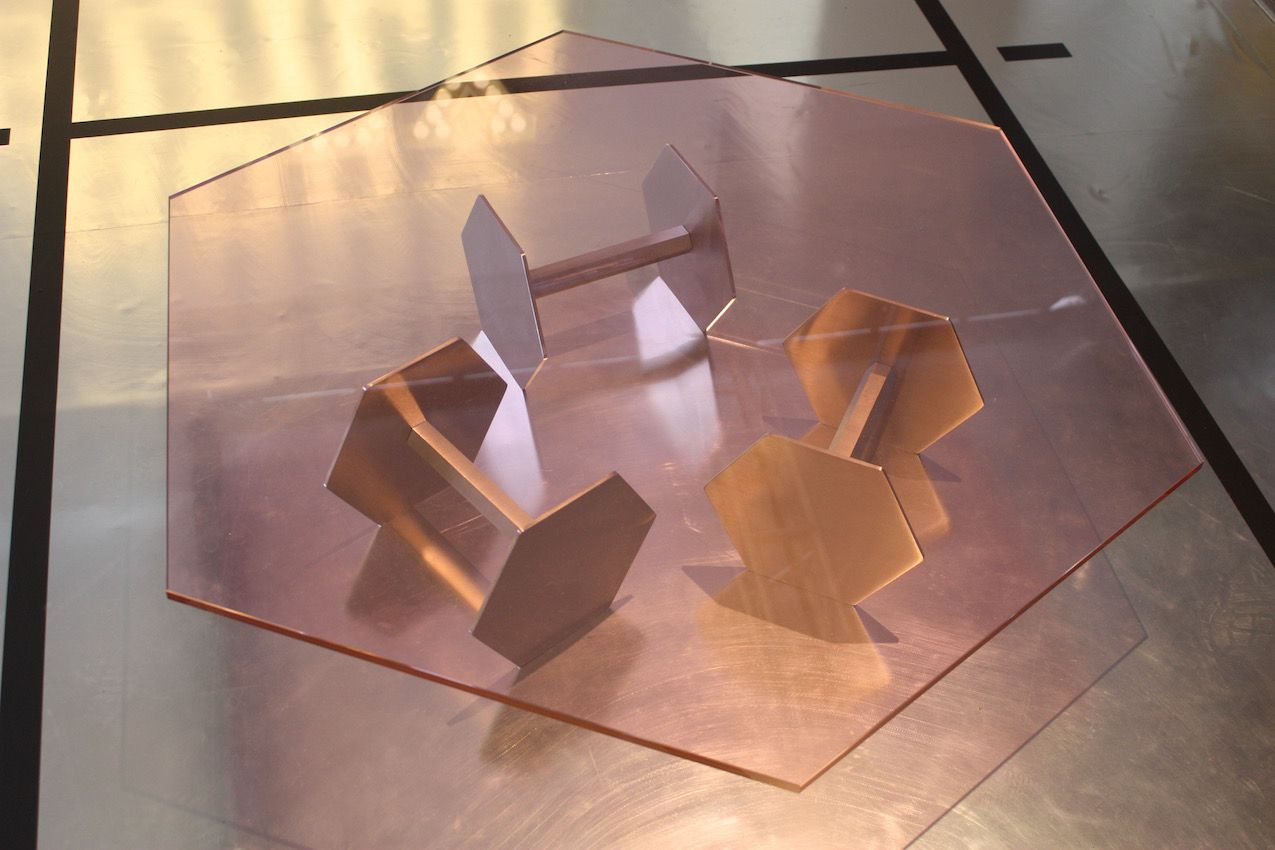 The Manure coffee table has a base of brushed steel with a pink crystal top.