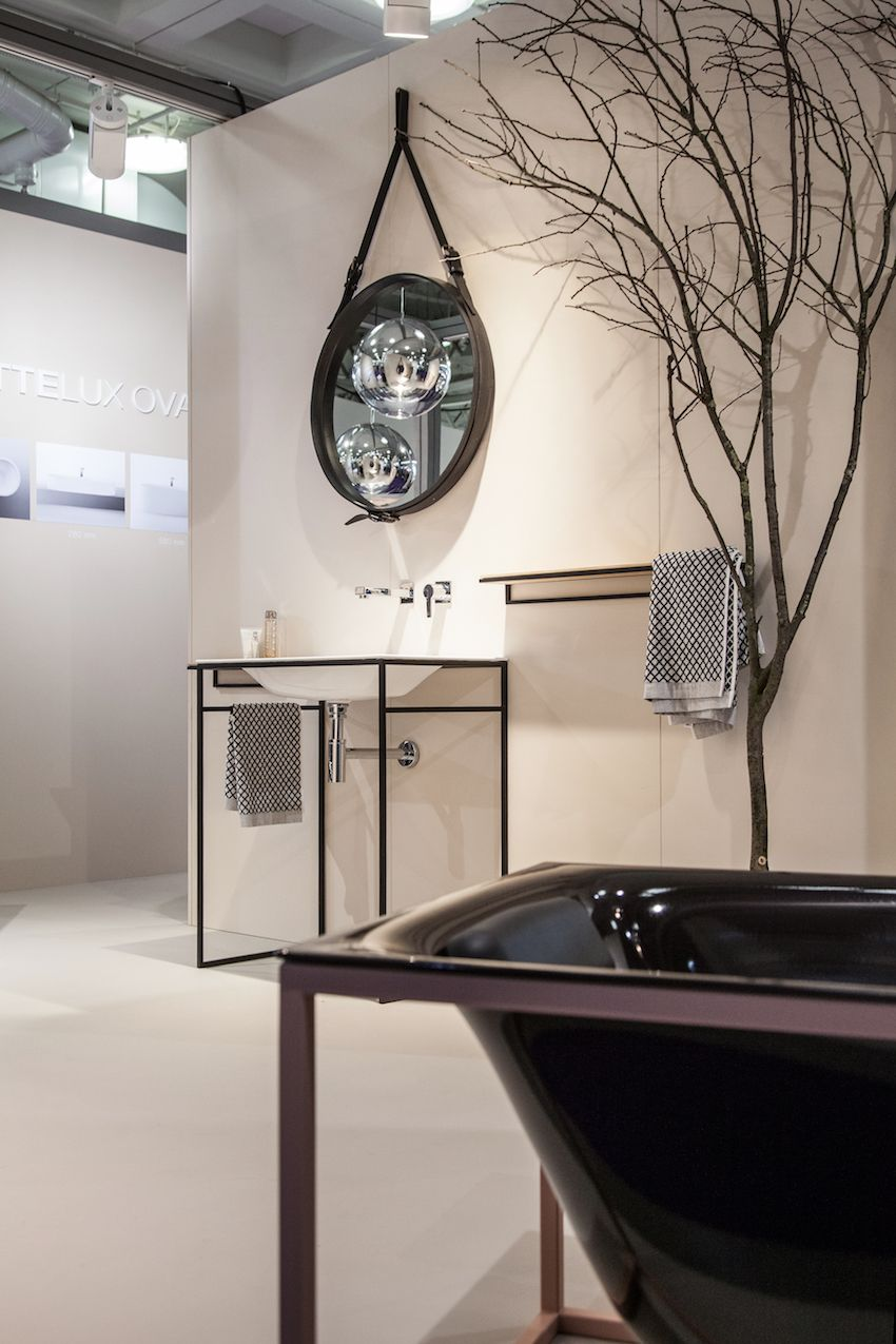 Minimal metal structures hold up the spare basin and shell-style tub.