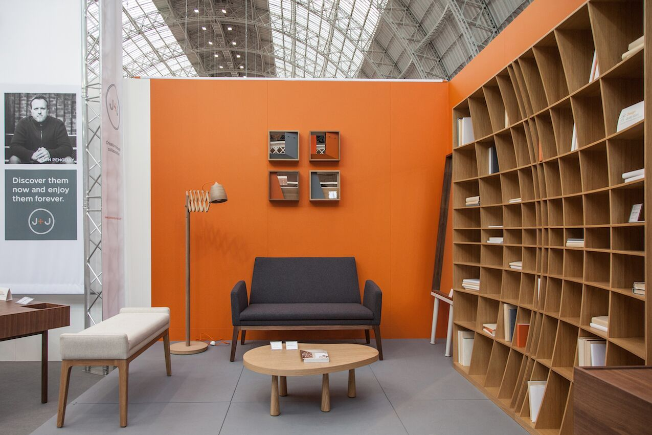 Orange wall around the curved bookcase