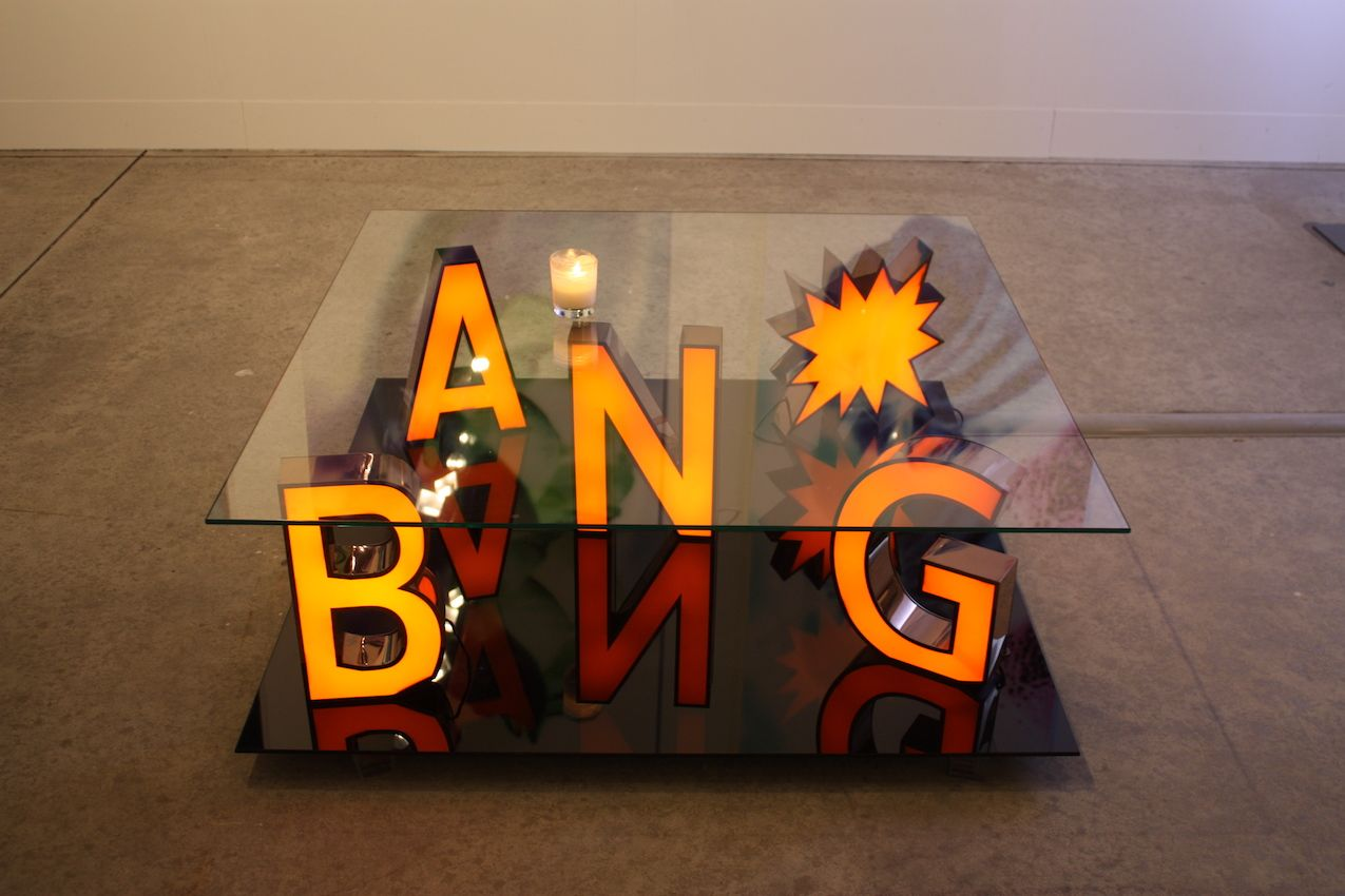 "Dutch gallery Preiveekollectie showed this ""BANG"" table created by Reinier Bosch. The gallery says that the famous pop-art paintings of Lichtenstein were used as for the piece."