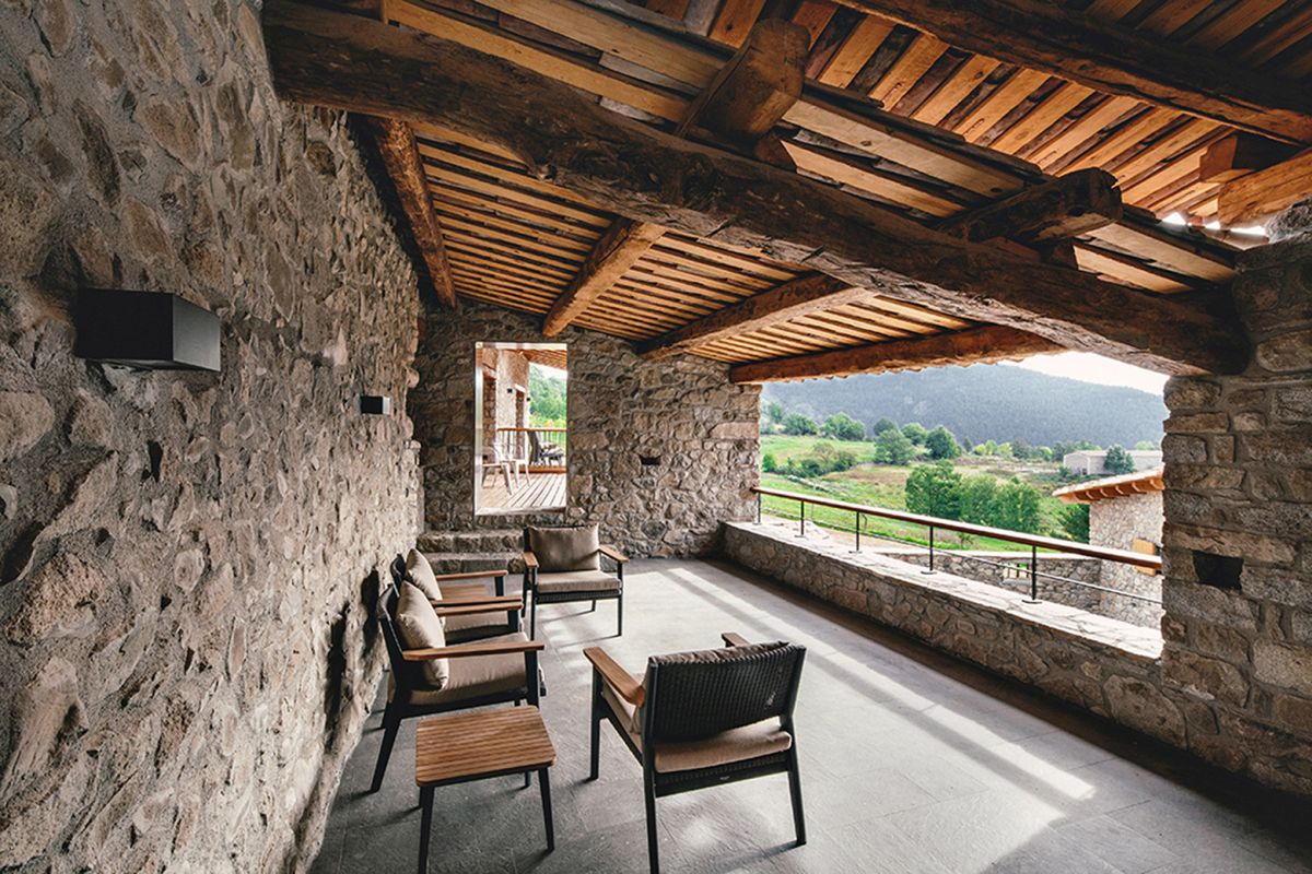 Rustic house gets rehabilitated in Spain - covered deck