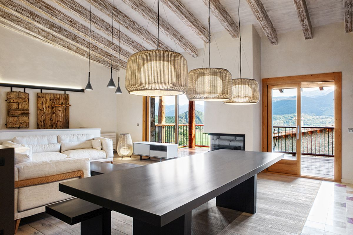 Rustic house gets rehabilitated in Spain - dining table pendant lamps