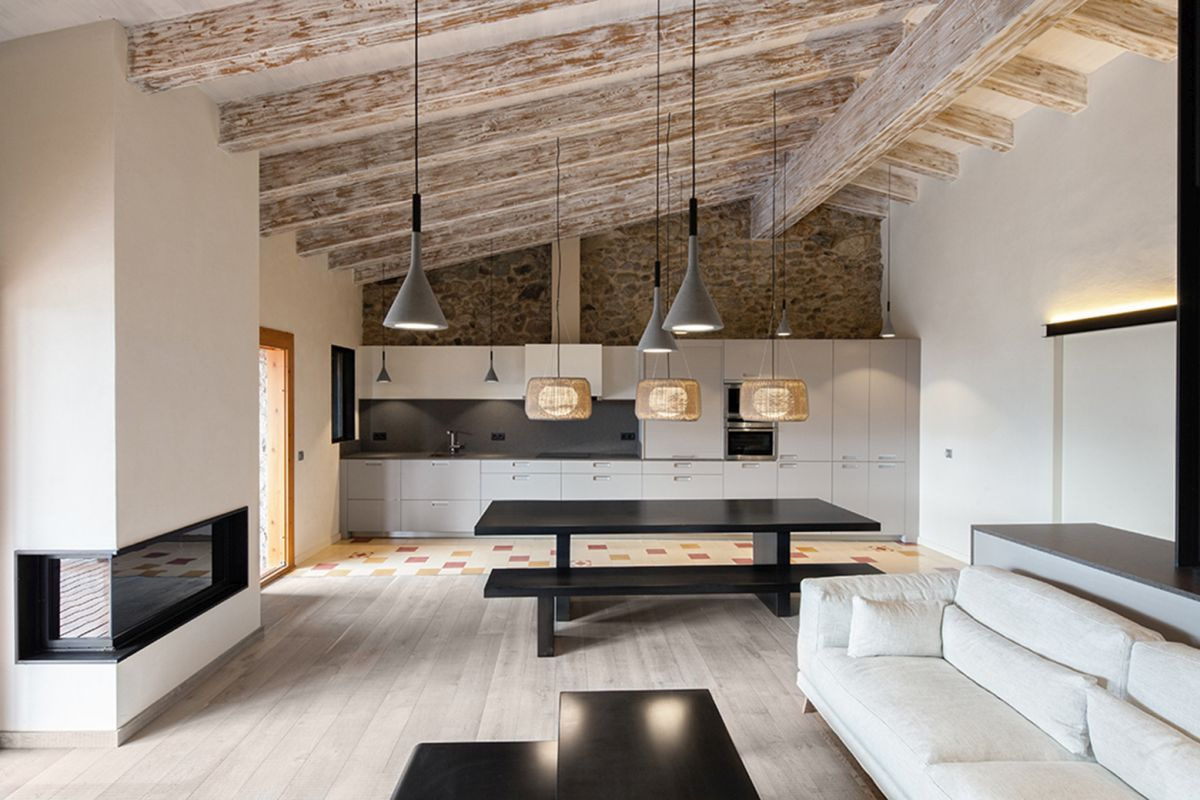 Rustic house gets rehabilitated in Spain - modern living room and open kitchen