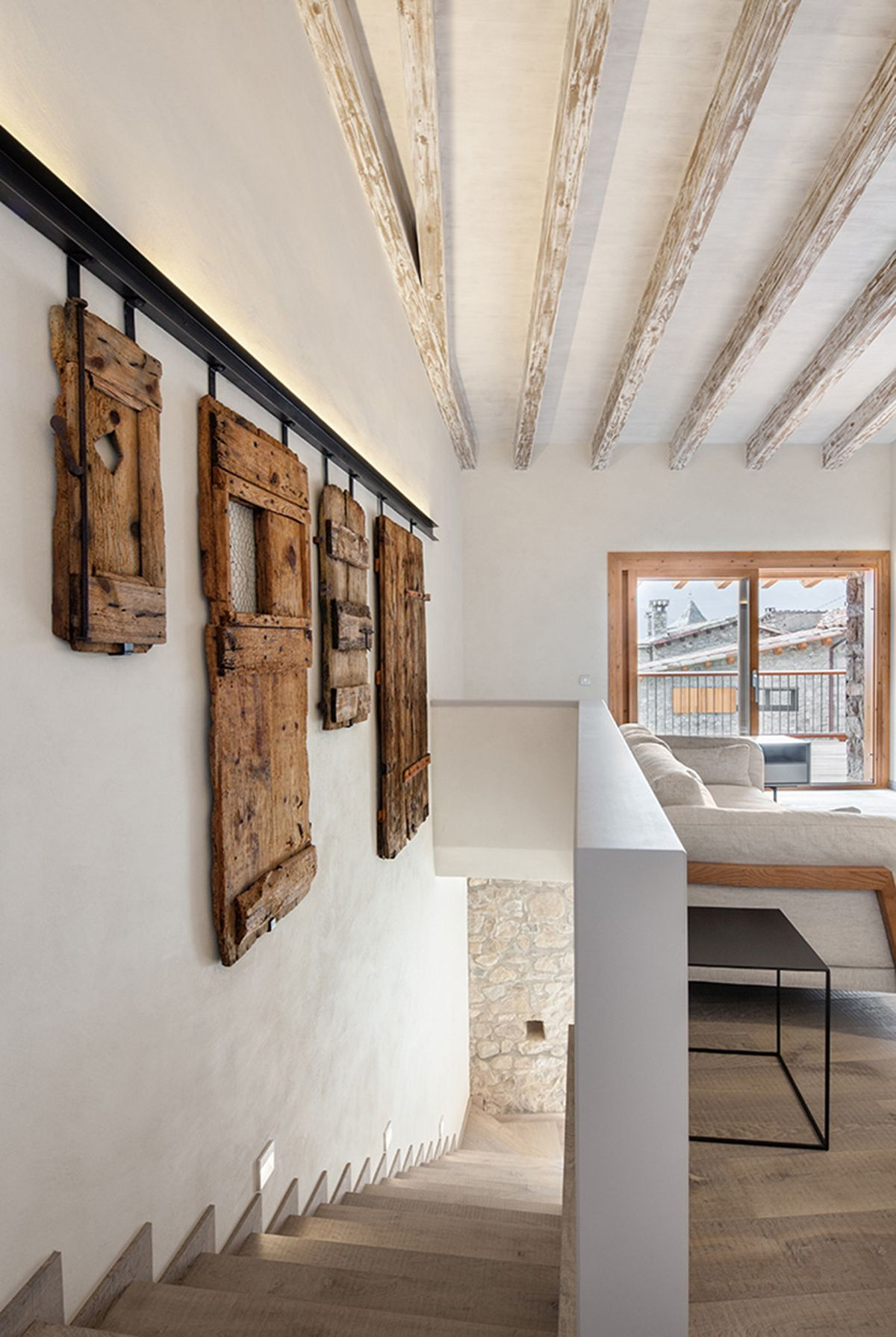 Rustic house gets rehabilitated in Spain - staircase wall deco