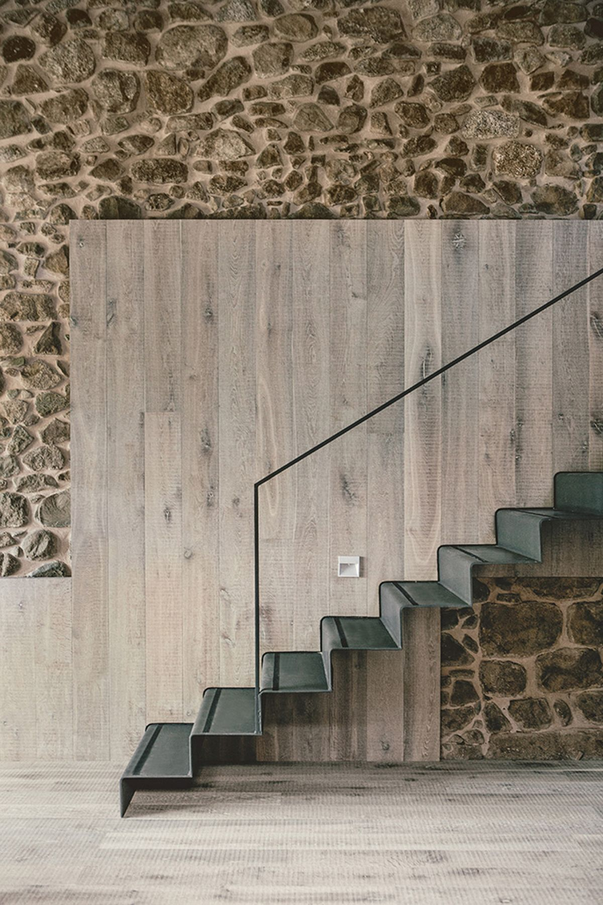 Rustic house gets rehabilitated in Spain - staircase wall