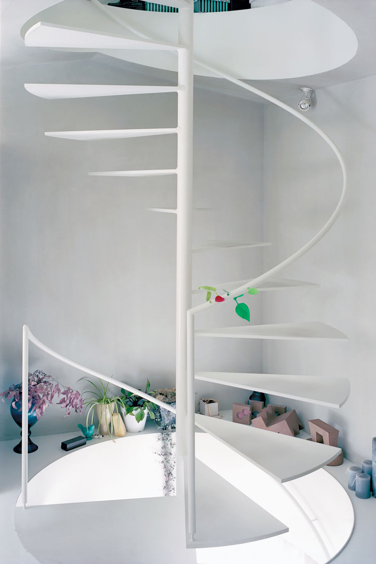 Simple metalic white spiral staircase