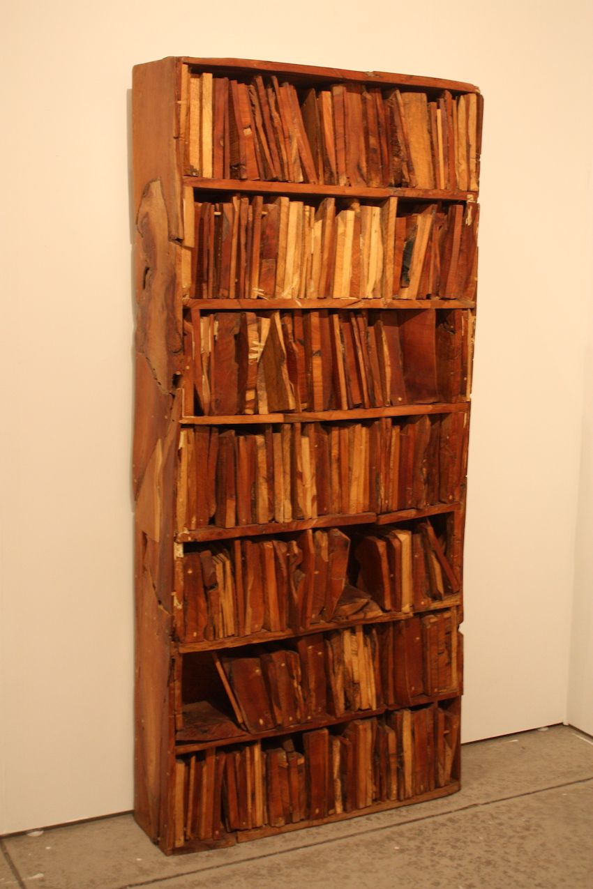 Spanish-born Manolo Valdés is a painter, sculptor, and printmaker. This bookcase is filled with slices of wood standing in for the usual book collection.