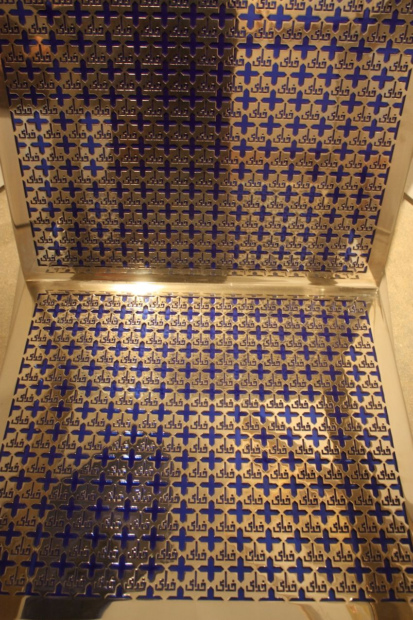 The intricately cut metal highlights the blue underlay which almost seems to glow under the bright lights.