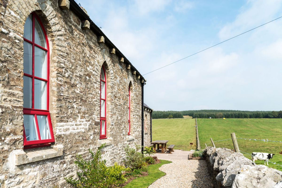 The Chapel holiday cottage red window frames and stone walls