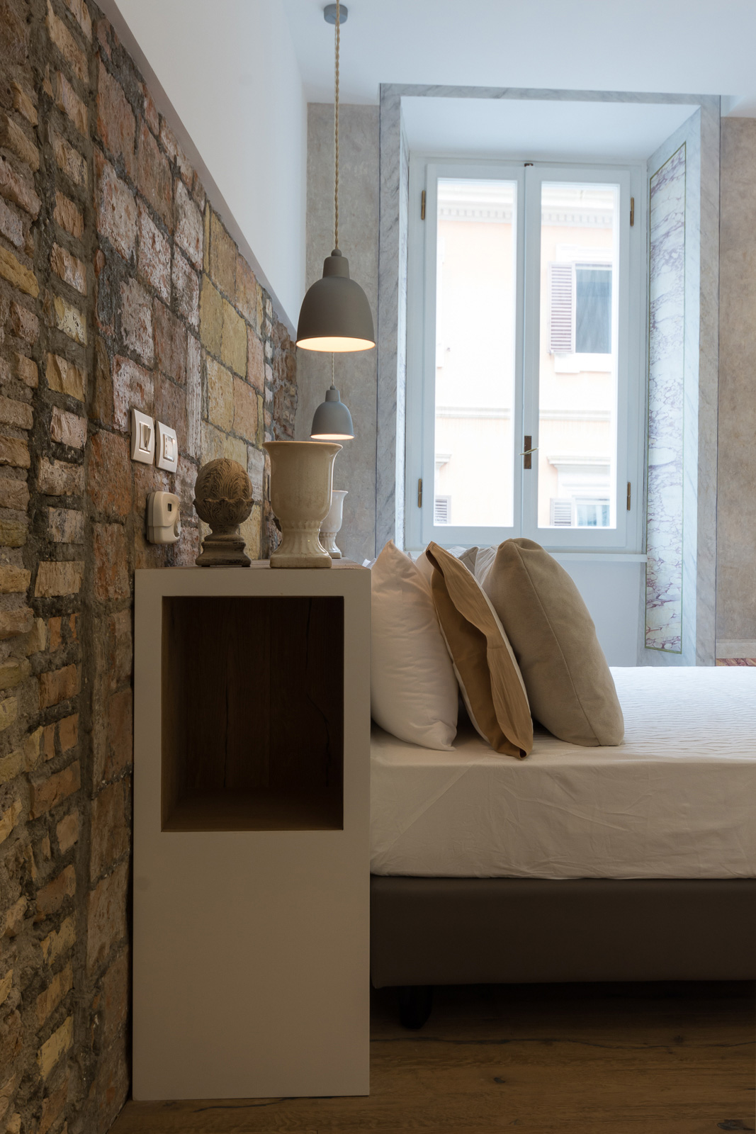 Via Sistina Apartment bedroom headboard and stone wall