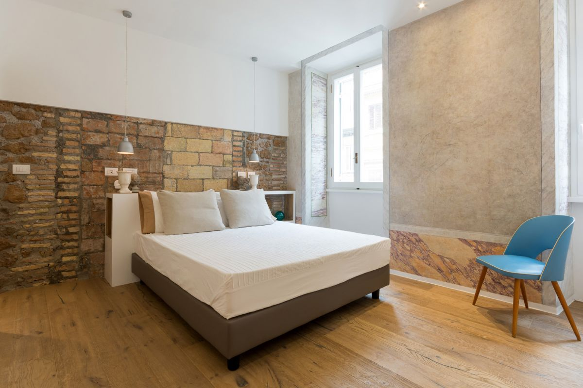 Via Sistina Apartment bedroom stone wall