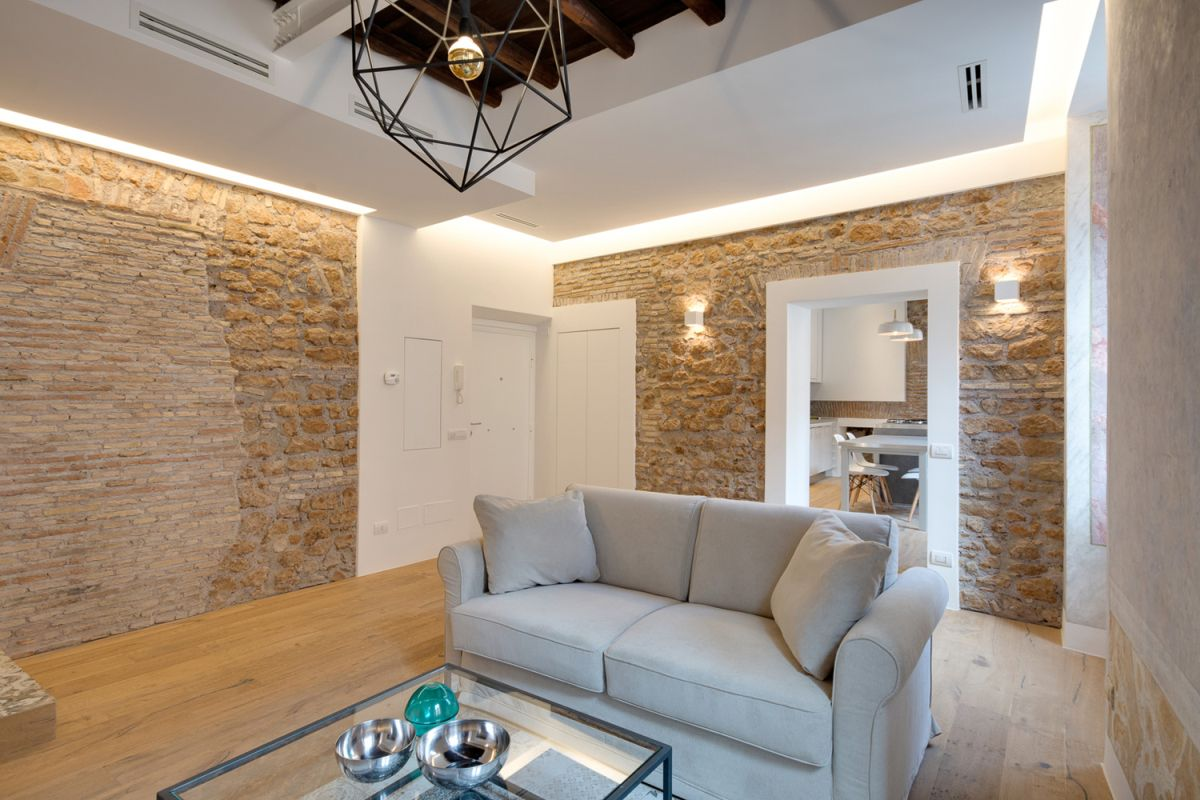 Via Sistina Apartment stone walls in living room