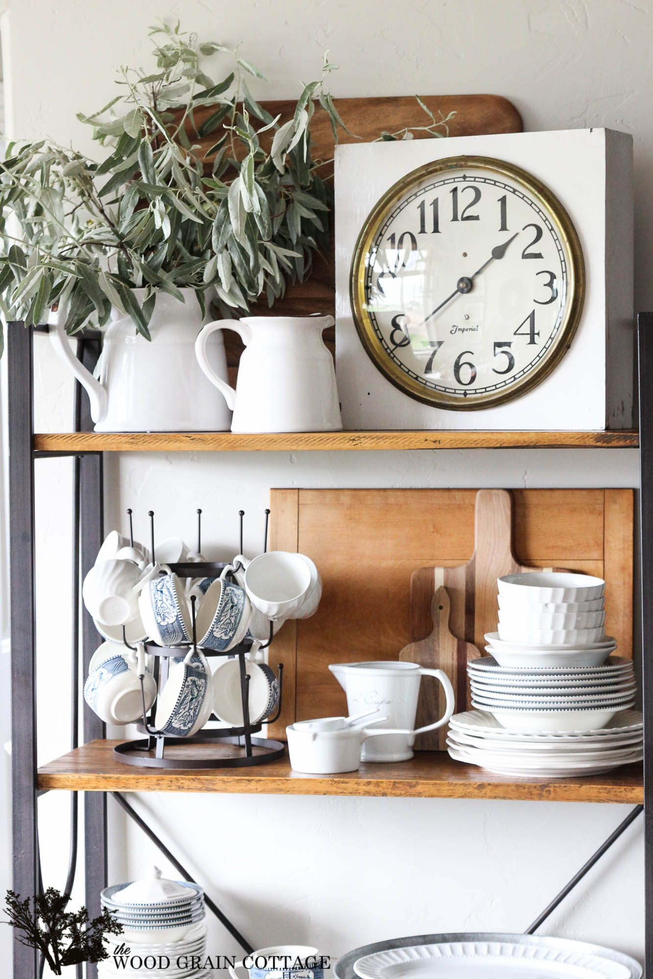 Vintage kitchen clock on shelves