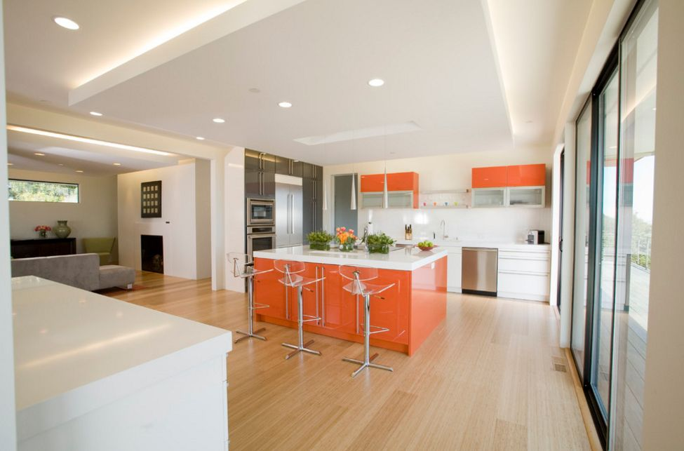 White and orange color kitchen scheme
