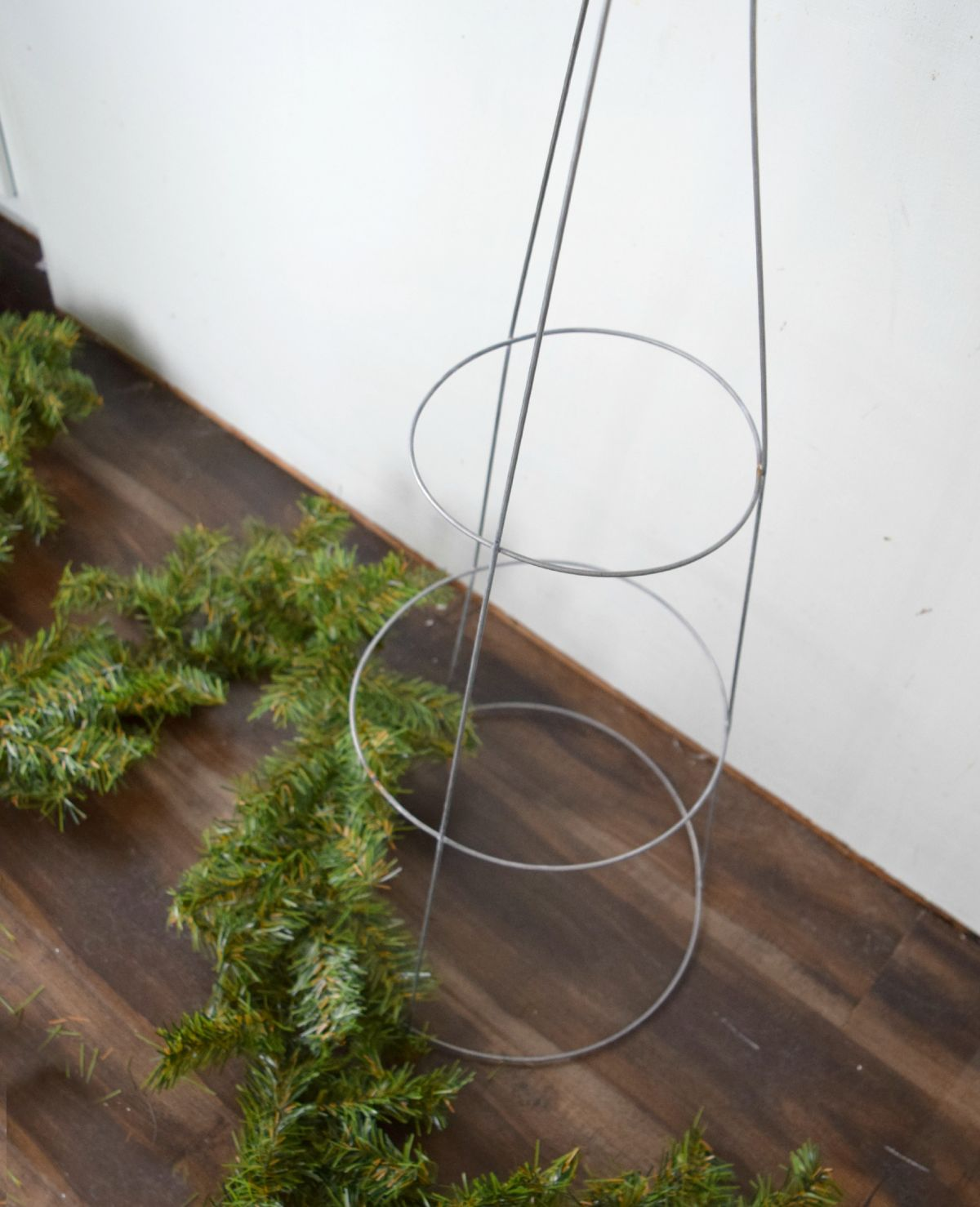 Winding garland around cage