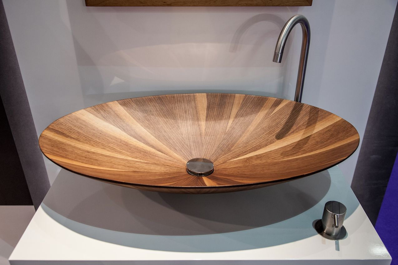 This wooden countertop basin is a stunning piece for any modern bathroom.