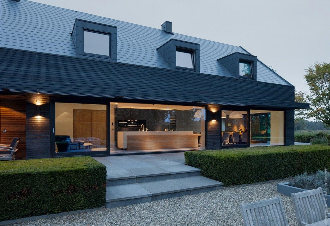 1960s House Updated With A New Modern Shell