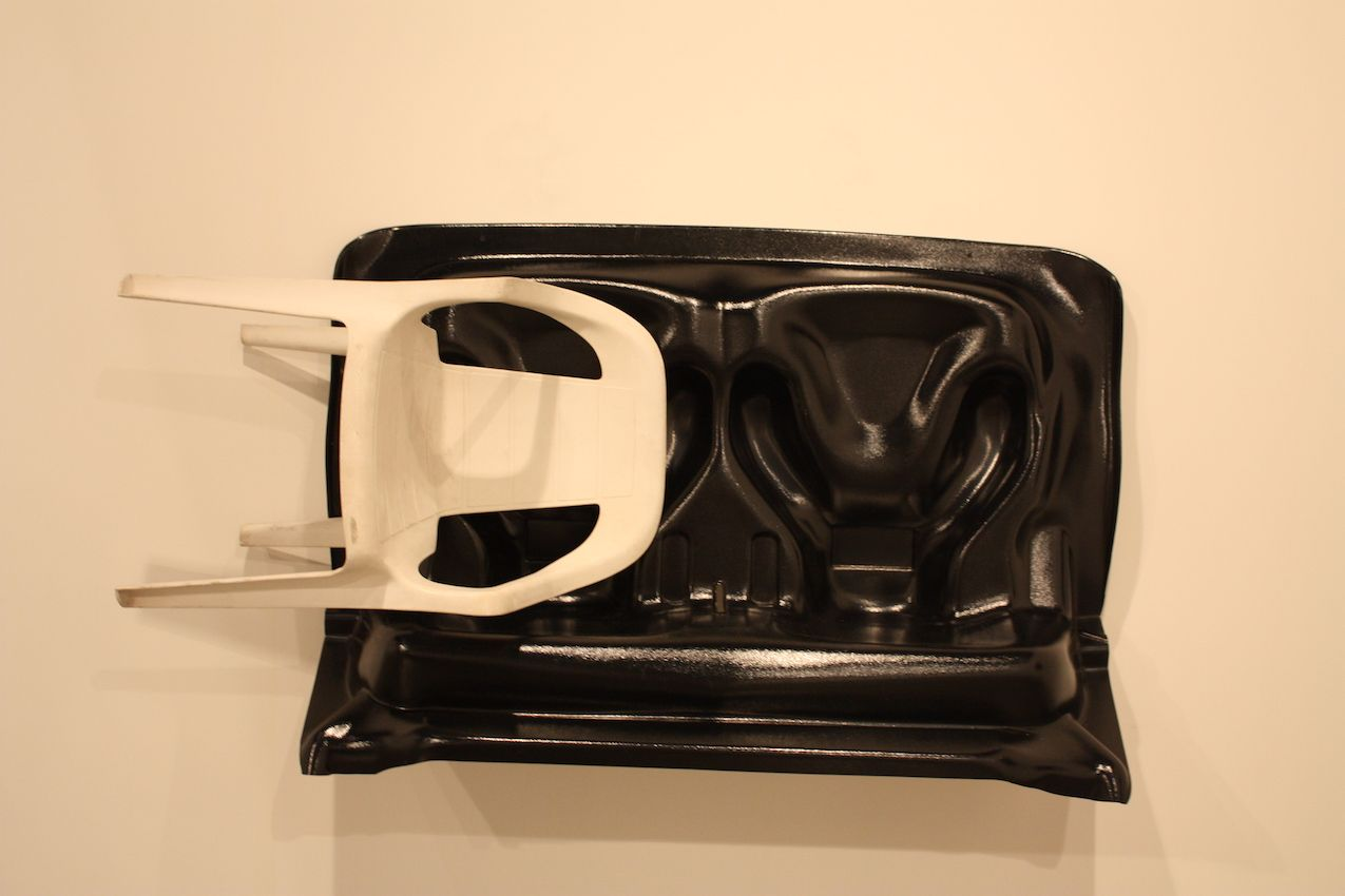 Another example of furniture as an art medium is this unexpected wall sculpture using seating shown by the Zero Gallery.