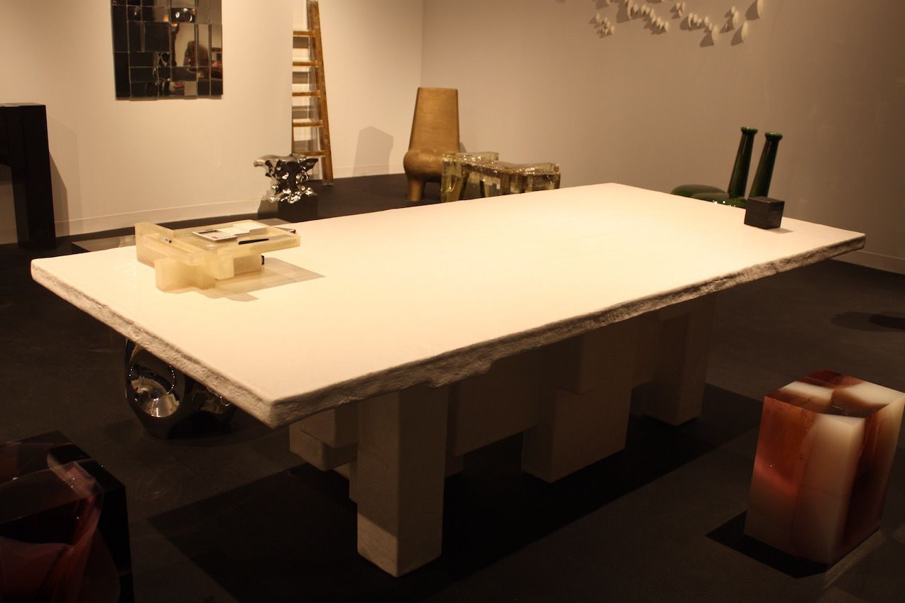 What may look like a typical table, this piece is actually a honeycomb structure made of corrugated cardboard that is covered with fiberglass and polyester resin.