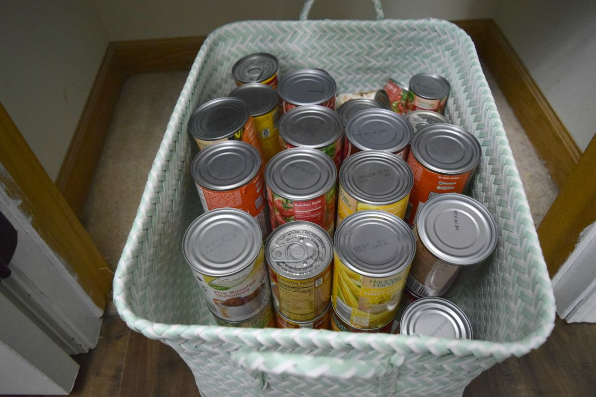 Basket storing cans in pantry