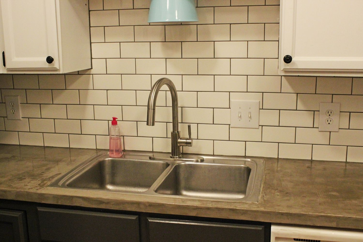 Beautiful kitchen update - light, backsplash and sprayer faucet