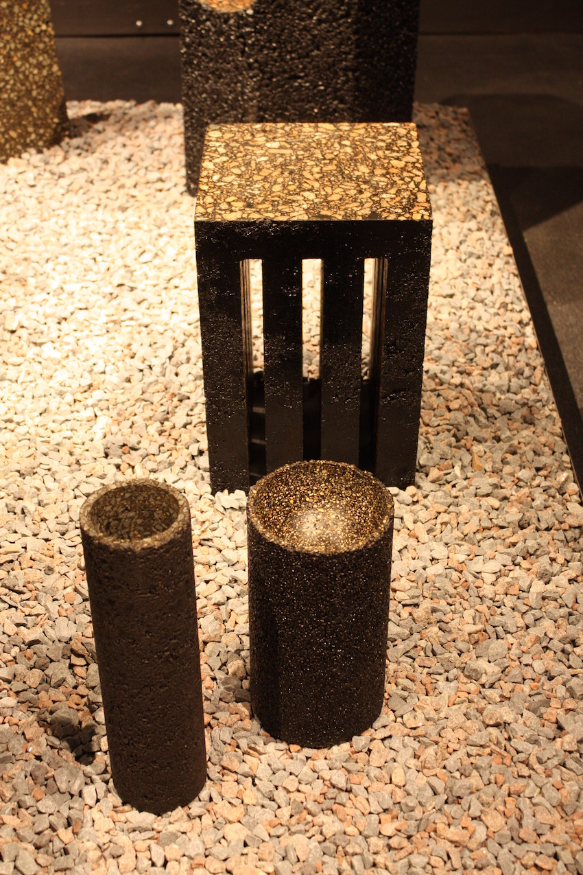 Modern chairs and stools do not have to be bold in shape or color. This stool and matching vase and vessel are neutral in color but are made from an unusual material: asphalt. This collection is called Black Gold by Quintus Kropholler.