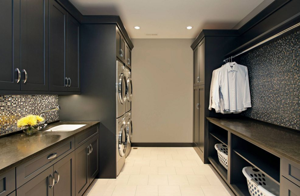 Black master laundry room with four stacked appliances
