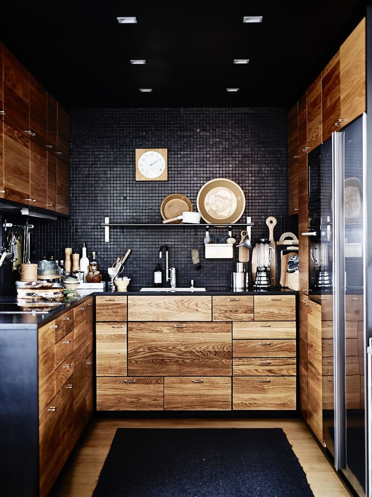 Black small tiles and wood cupboards