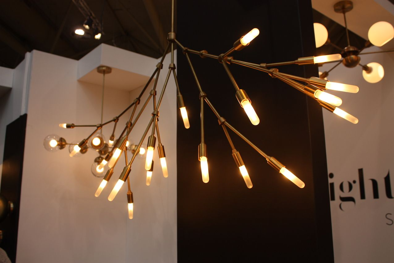 In a trend that doesn't seem to be going away, the branch style light was shown by Lightmaker Studio. Available in brass and copper, the tree-like structure is fully customizable. The uniquely shaped bulbs are a sophisticated touch.