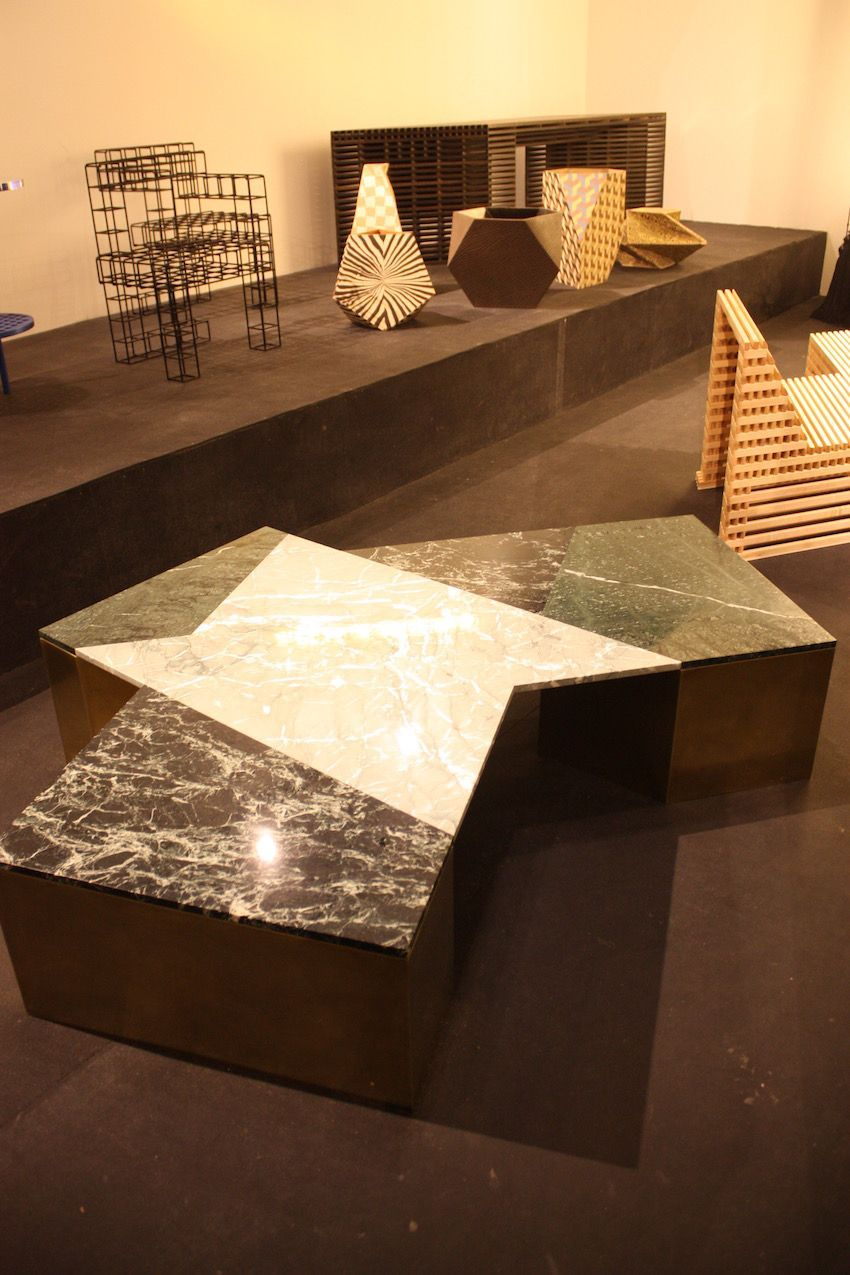 LA-based designer Brian Thoreen created this geometric coffee table in mixed black marbles, brass, steel, and wood. Handles by the Patrick Parrish Galery, the table comes in various colors.