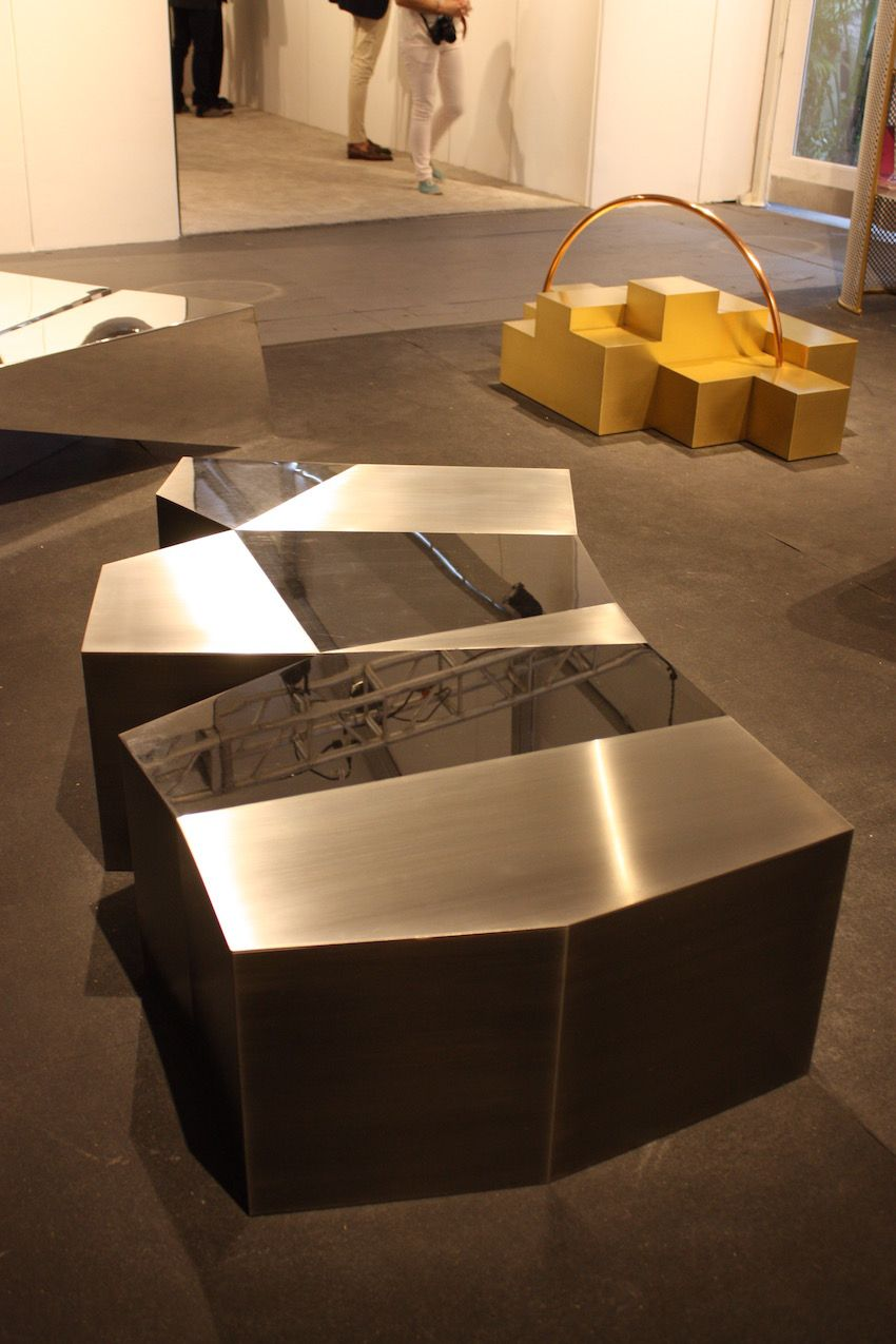 This table is also from Cherkerdjian's Trans Form collection and is made of stainless steel.